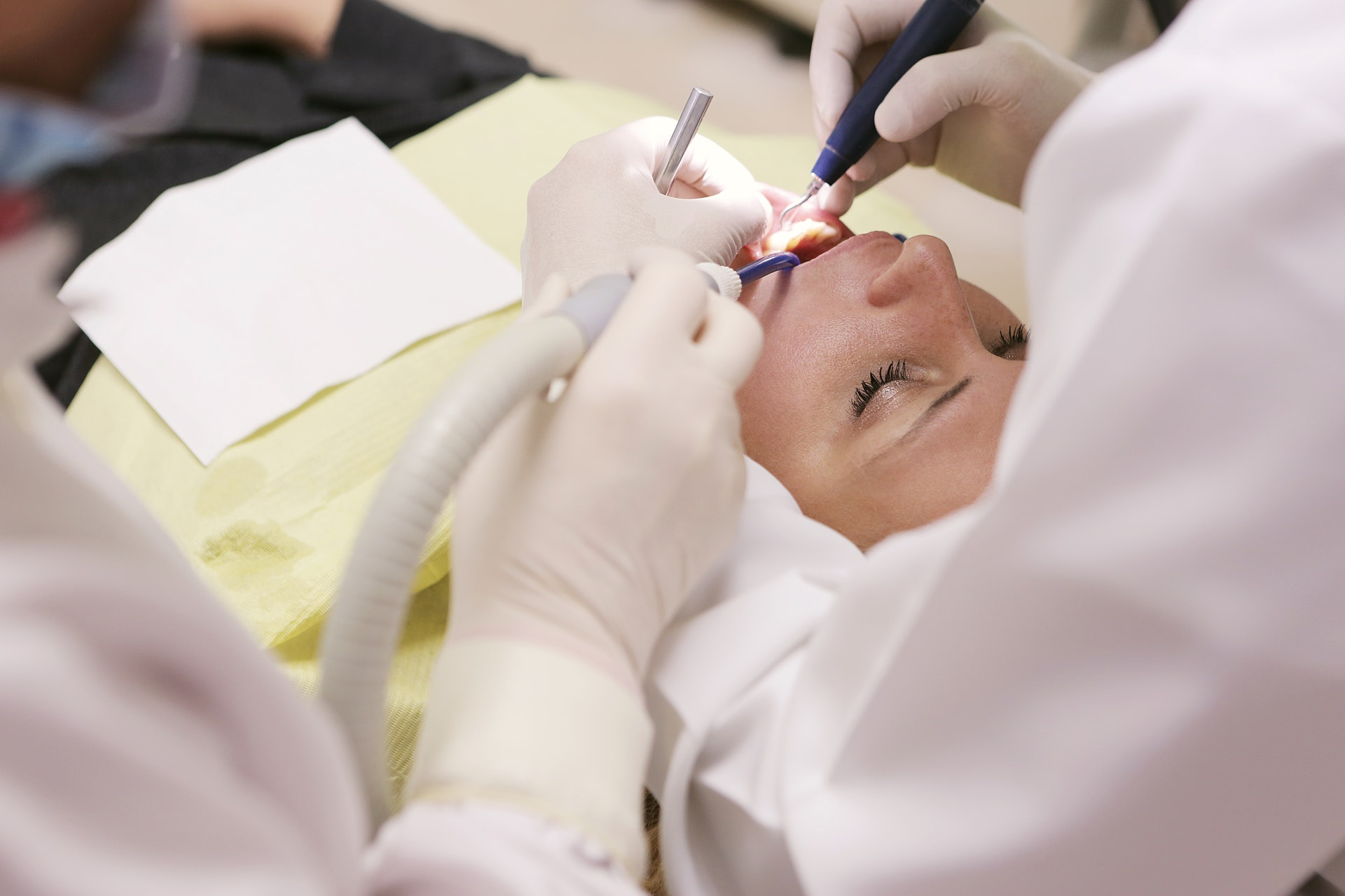 a woman getting a plastic surgery procedure completed