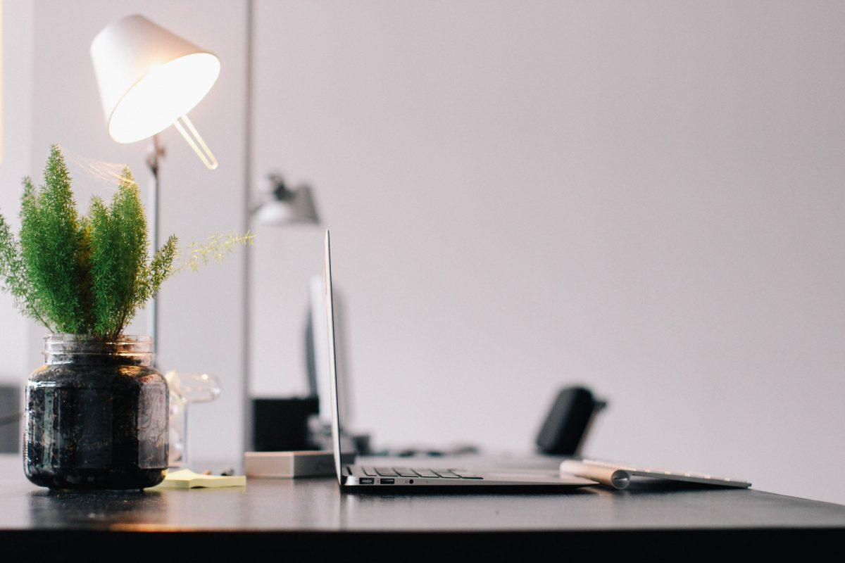a clean desk with a laptop