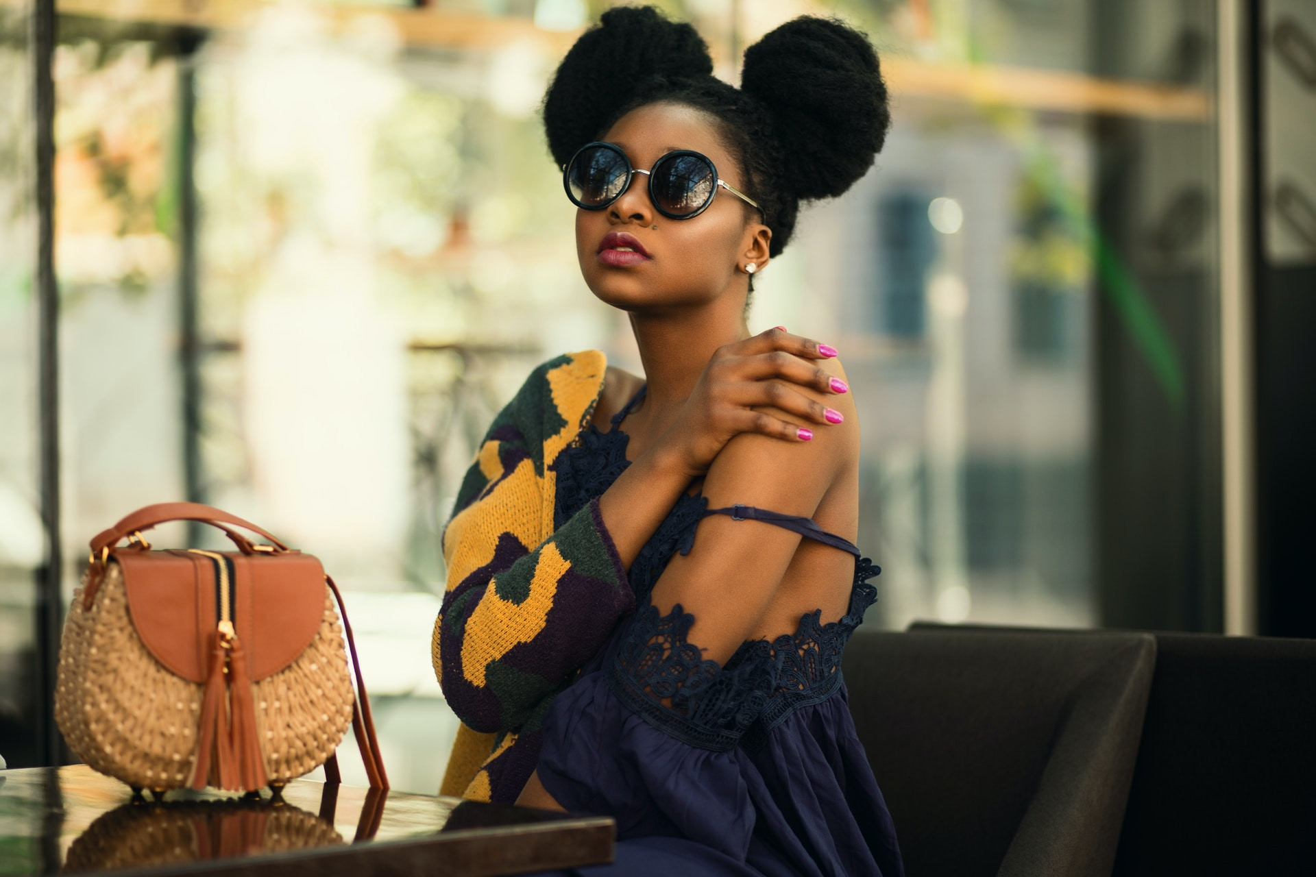 woman wearing a dress with a handbag