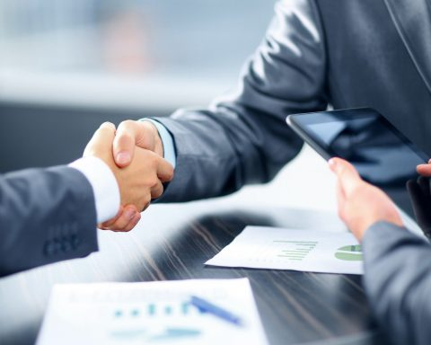 shaking hands after agreeing a loan