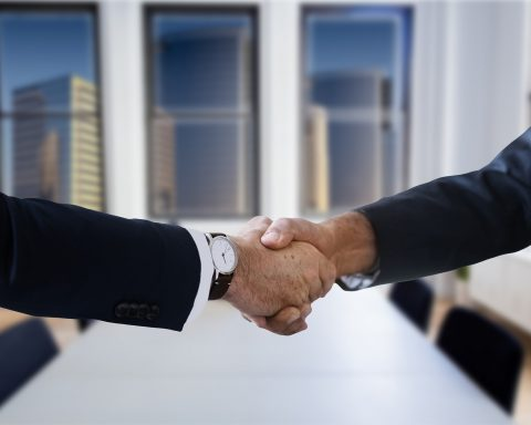 selling a business shaking hands