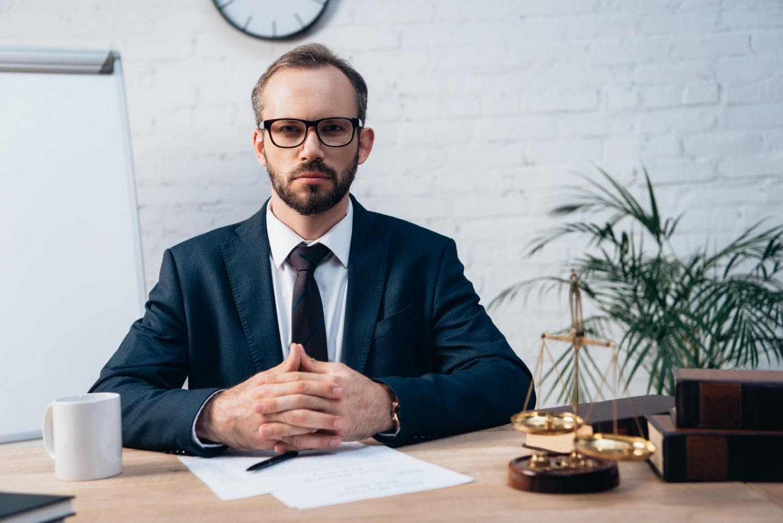 lawyer sitting at desk